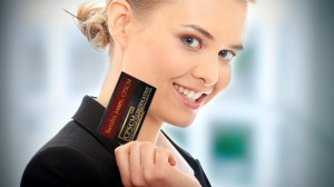 Business Woman holding CPSCM Business Card